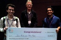 Jatin Mistry (R) and colleagues with award cheque